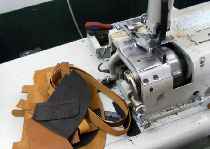One of the many machines used in leather sewing.