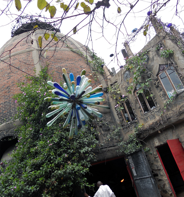 An ornate outdoor chandelier graces the beautiful exterior of this hot glass art studio