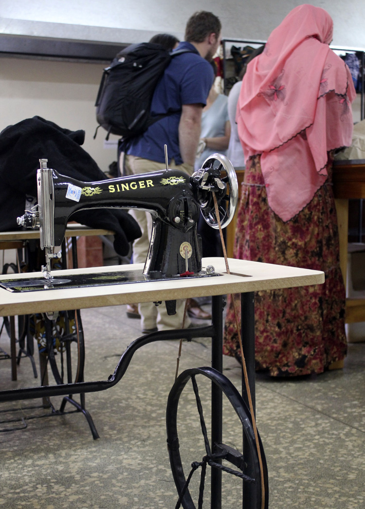 Widows and single mothers are taught to sew and then given a sewing machine upon graduation from the class.